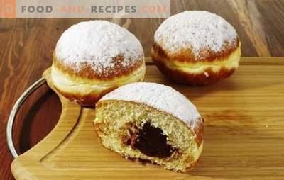 Ruddy Donuts mit Füllung - auch auf dem Tisch, auch unterwegs. Ein schneller Snack kann mit Obst gefüllte Donuts