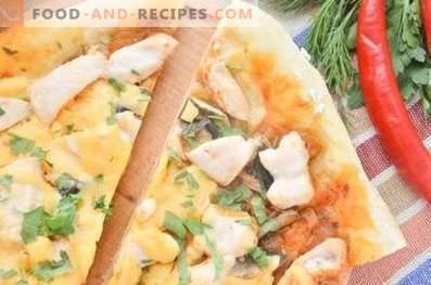 Pizza mit Hähnchen, Pilzen und Pfeffer