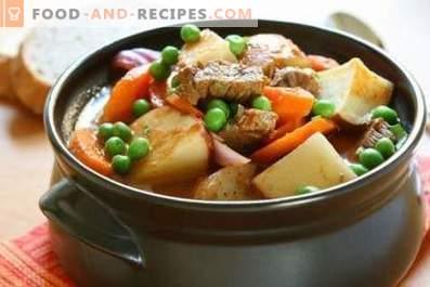 Schweinerippchen mit Kartoffeln in Töpfen