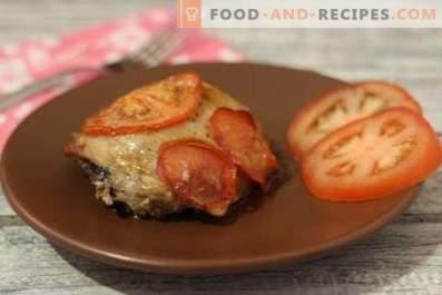 Hähnchenschenkel mit Tomaten im Ofen