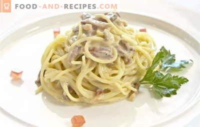 Spaghetti in einer cremigen Sauce mit Hähnchen, Schweinefleisch und Fisch. Schnelle und festliche Spaghetti-Gerichte in Sahnesauce